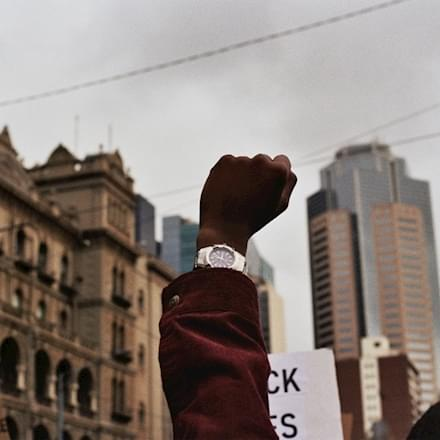Black man's fist raised in the air during a Black Lives Matter Protest