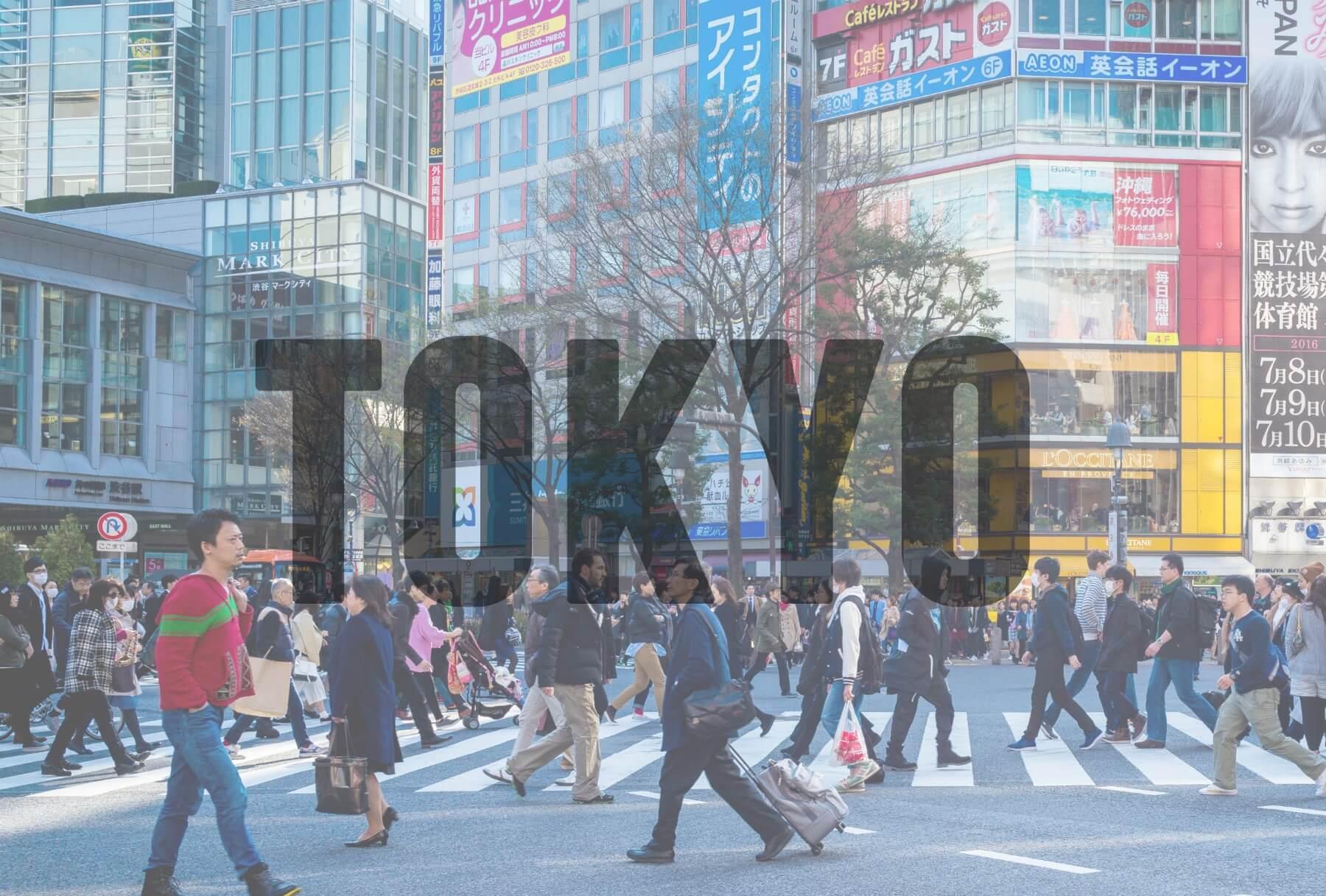 'TOKYO' (People crossing road in city)