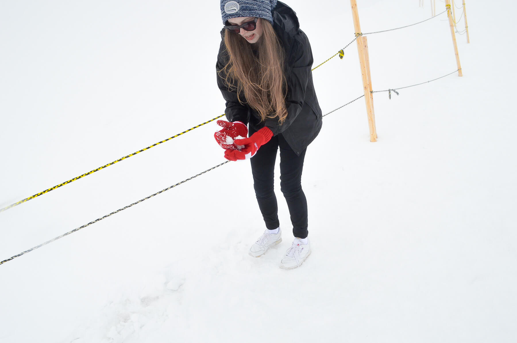 Girl building a snow ball at Jungfraujoch, Switzerland