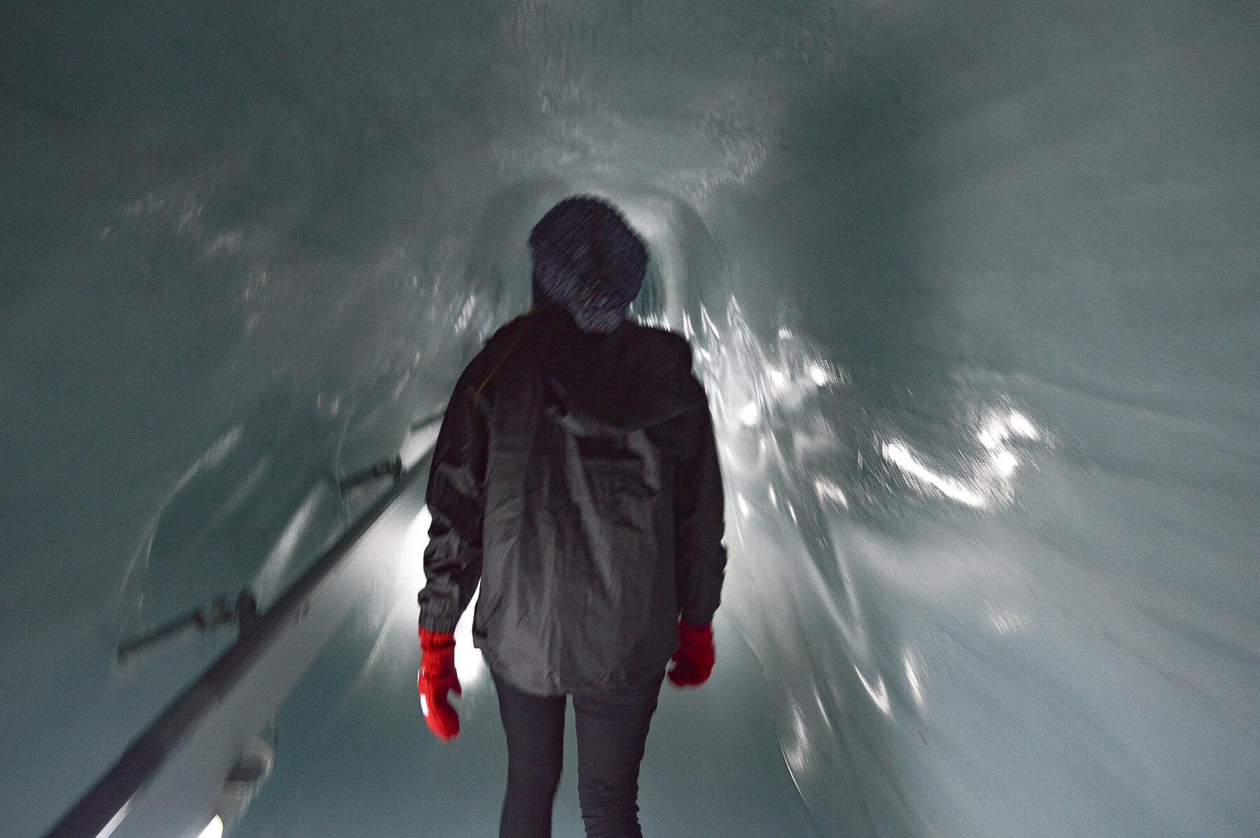 Girl walking through Ice Tunnel at Jungfrau