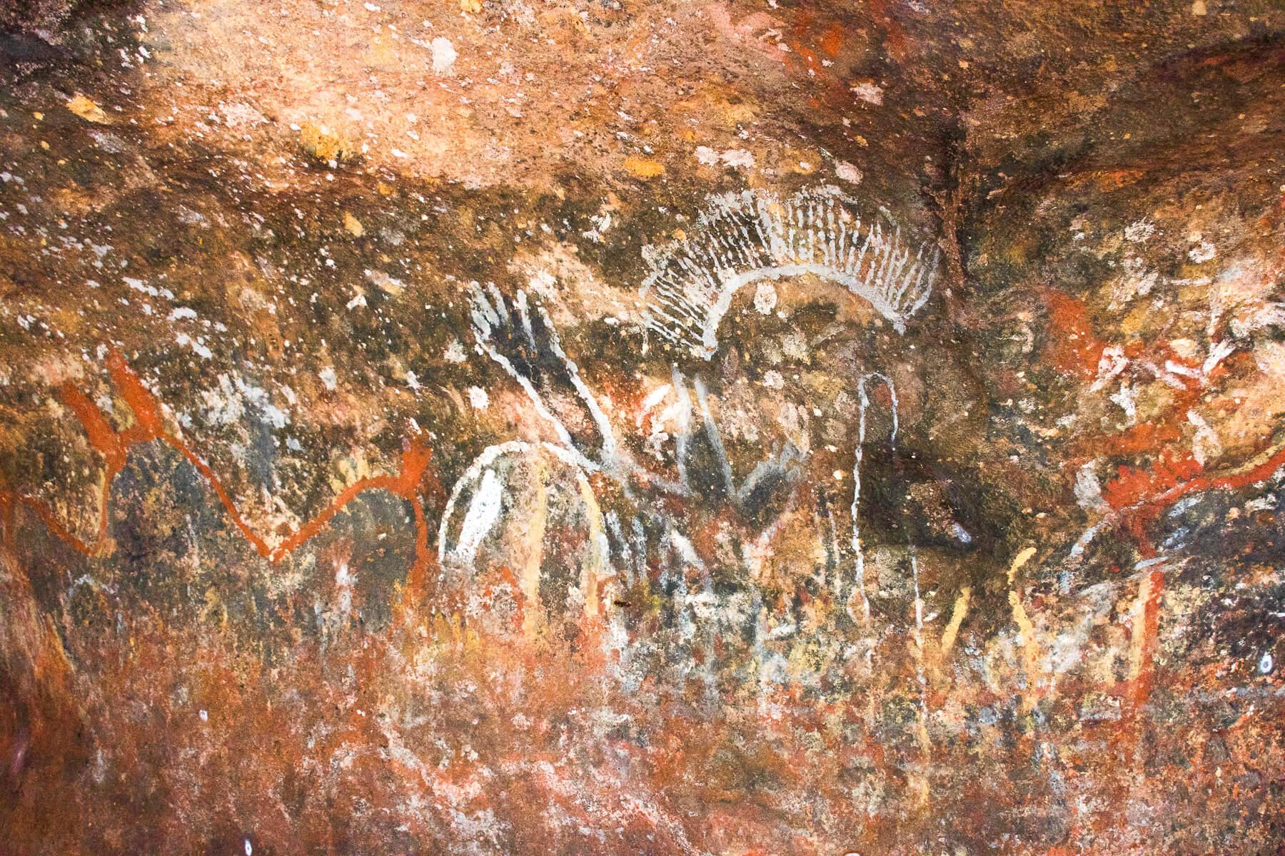 Aboriginal paintings in a cave on Uluru