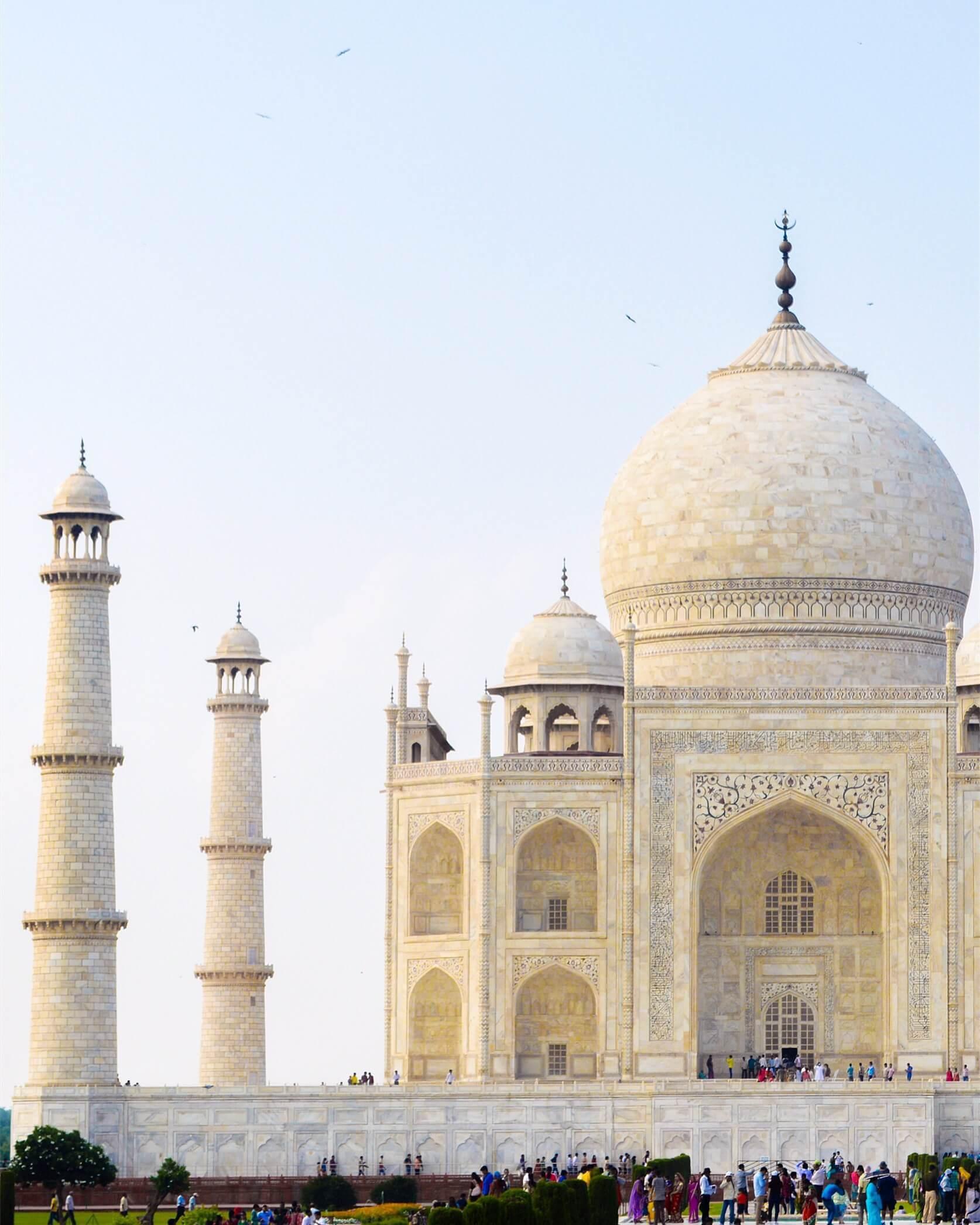 The Taj Mahal main building and pillars shining gold in the sunlight