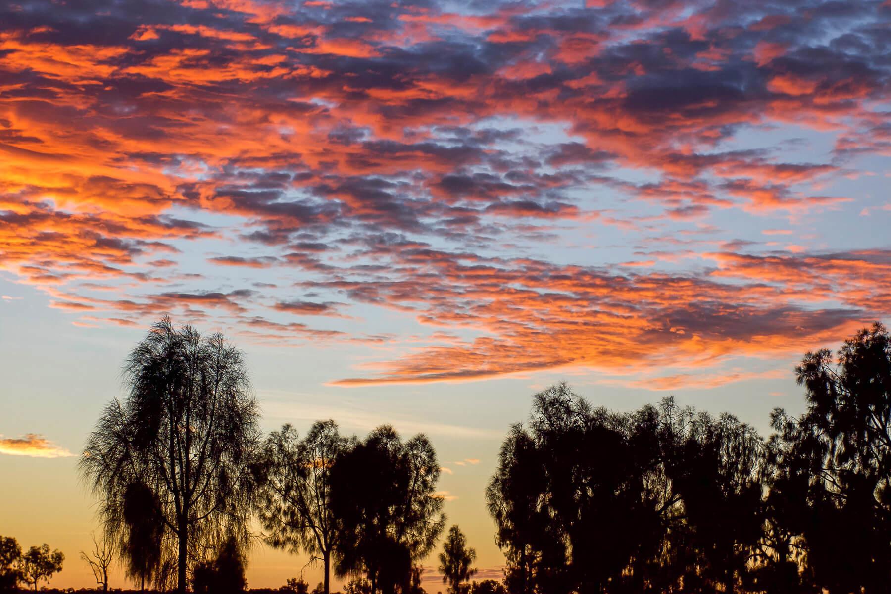 Bright Orange clouds as the sun rises