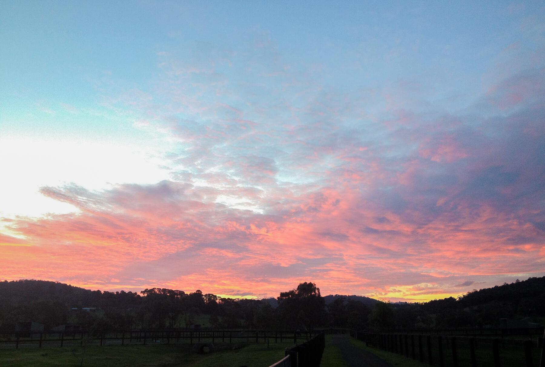 Pink clouds above an Australian farm