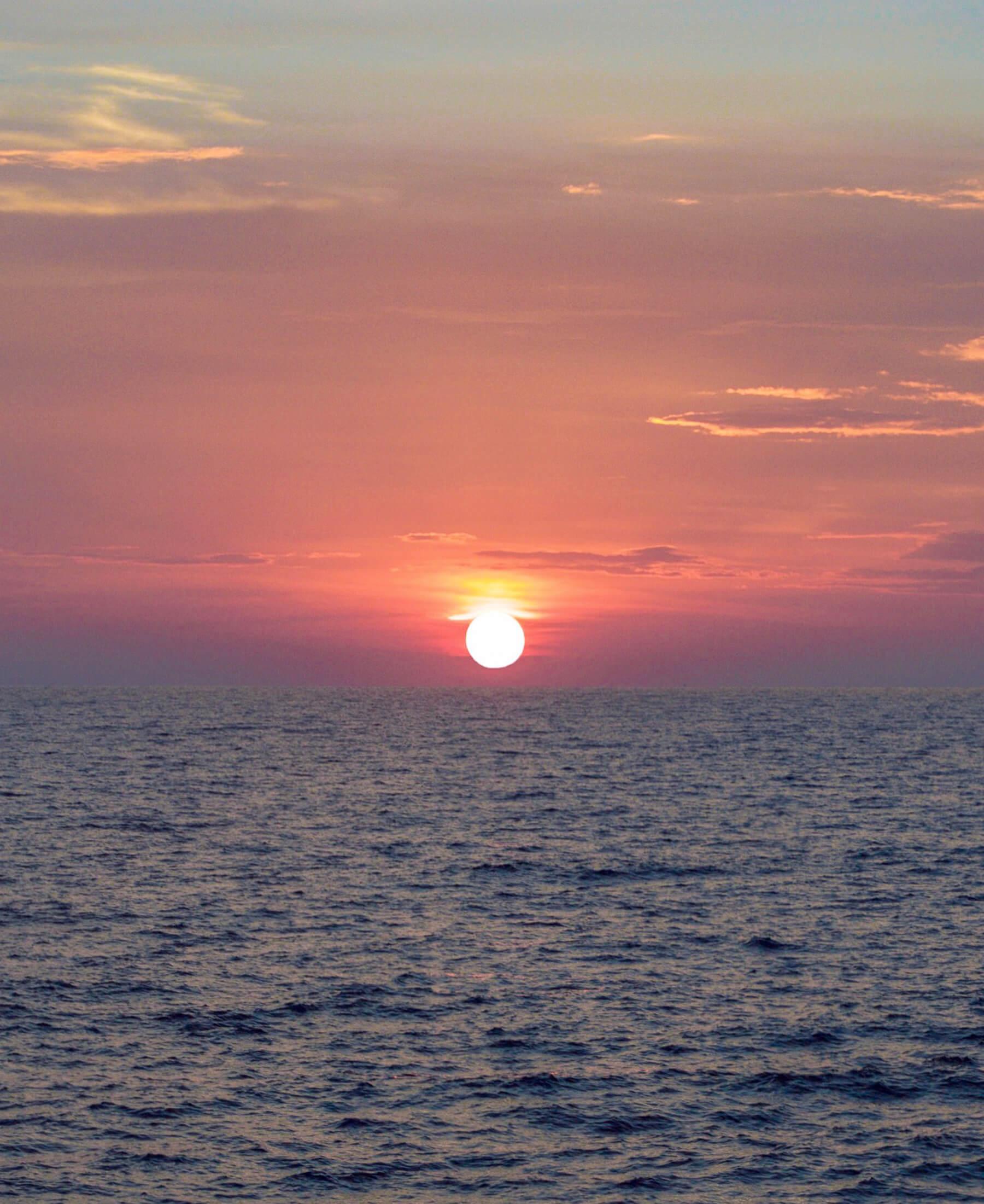 Huge sun above the ocean