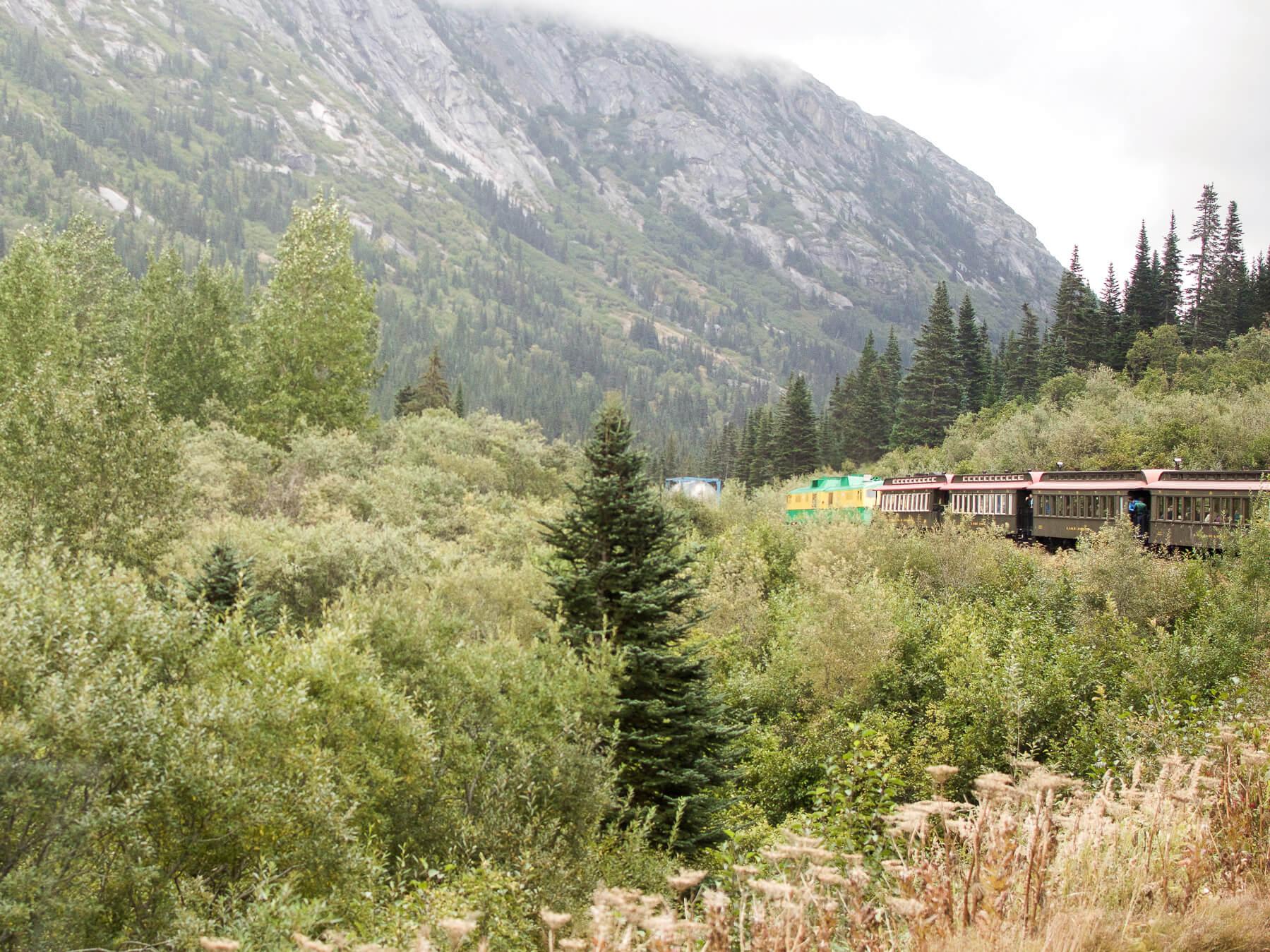 Old train chugging through the Alaskan Valley