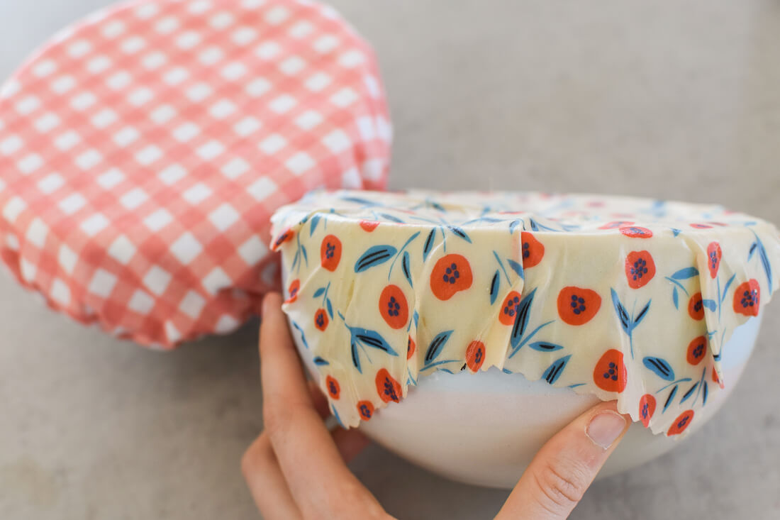 2 bowls covered in beeswax wraps and a fabric cover